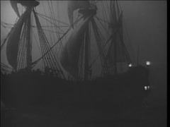 17th century reenactment of ship sailing on foggy night - stock footage