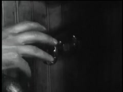 Closeup of man turning doorknob, 1960s - stock footage