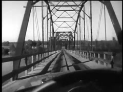 Interior point of view from car driving over bridge, 1960s Stock Footage