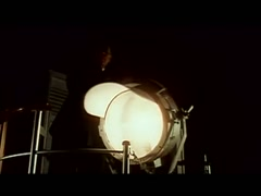 Man on deck of ship turning on searchlight, 1960s - stock footage
