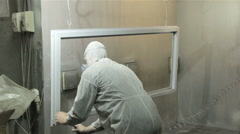Worker in protect suit painting window with powder - stock footage