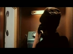 Rear view of woman dialing  phone in European telephone booth, 1960s Stock Footage