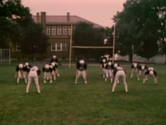 Stock Video Footage of High school football team warming up before game, 1980s