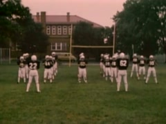 Stock Video Footage of Front and side view of high school football team preparing for game, 1980s
