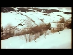 Skiers skiing down snow capped mountain in the Alps, 1960s - stock footage