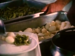 Workers serving food in cafeteria, 1980s - stock footage
