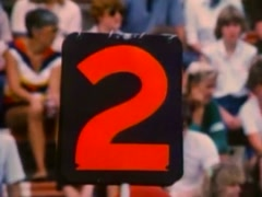 Down marker changed from first to second down at high school football game, 1980 Stock Footage