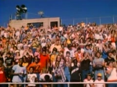 Spectators cheering in outdoor bleachers, 1980 - stock footage