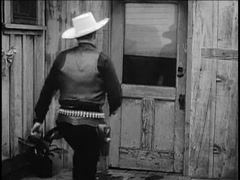 Rear view of cowboy kicking in wooden door, 1940s Stock Footage