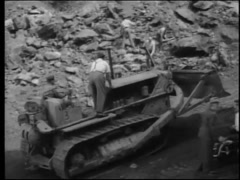 Workers bulldozing damaged mine, 1950s Stock Footage