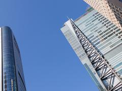 geometric architectural abstraction and blue sky - stock photo