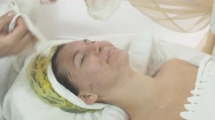 Female cosmetologist wipe out woman face and neck by napkins in beauty saloon Stock Footage
