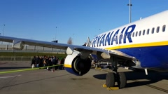Brussels South Charleroi Airport, Belgium. Ryanair passengers boarding plane. Stock Footage