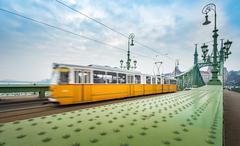 Tram on Liberty bridge in Budapest, Hungary. - stock photo