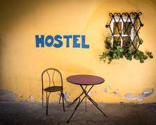 Old town street in Europe with hostel sign. Stock Photos