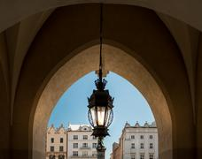 Old lamp and Krakow architecture. Poland, Europe. Stock Photos