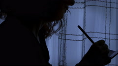 Suicide woman writes furiously a last letter Stock Footage