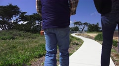 Point Pinos lighthouse, couple walking Stock Footage