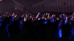 Cheering crowd fan spectators jump dance raise hands in concert flash lumiere - stock footage