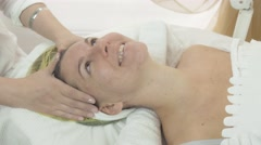Happy woman face with in beauty saloon after cosmetic procedures. Look in camera - stock footage