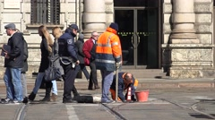 4K Worker team repair sewerage system downtown Milan police man protection road Stock Footage