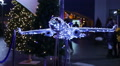 Decorative airplane made of sparkling twinkle lights at airport, Christmas tours Footage