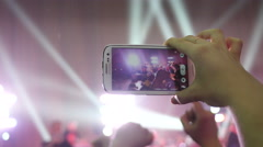 Stock Video Footage of Spectator hands holding shooting video via smartphone of a concert flash lumiere