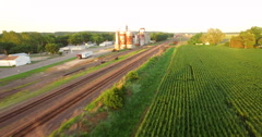 Aerial of freight train passing through the field in Kansas City - stock footage