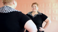 Fat girl is engaged in dances in the hall. cheerful plump, gymnastics and dance Stock Footage