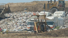 Trash being pushed around at the Dump Stock Footage