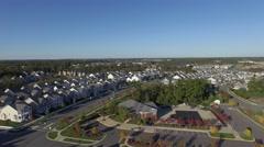 An aerial establishing shot of a suburban neighborhood, 4K UHD Stock Footage