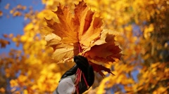 Female hand in glove holding bundle of maple leaves and removes it Stock Footage