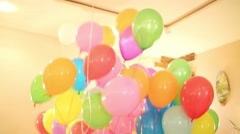 Multicolored balloons filled with helium on the holiday Stock Footage