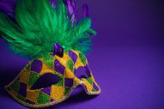 Assorted Mardi Gras or Carnivale mask on a purple background Kuvituskuvat