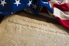 Stock Photo of United States Declaration of Independence with vintage flag