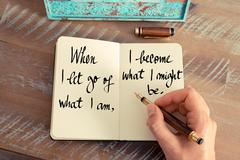 When I let go of what I am, I become what I might be - stock photo