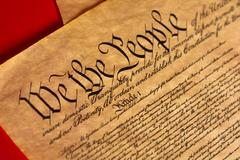 A parchment of the Constitution with a red background Stock Photos