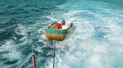 Rescue boat floats on the sea tied to the boat - stock footage