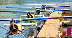 4K Seamless Loop Clip, Seaplanes Lined up at Dock Stock Footage