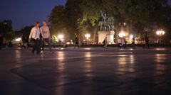 People walk next to the statue of Charlemagne in the evening Stock Footage