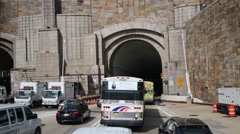 Many cars enter the Lincoln Tunnel under the Hudson River Stock Footage
