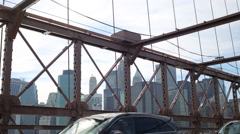 Skyscrapers in Manhattan, view through the wire ropes of Bridge Stock Footage