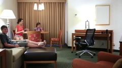 Parents with son and daughter sitting in the spacious living room Stock Footage