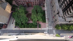 Square with trees and a fountain near high-rise building Stock Footage
