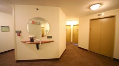 Hallway with lots of doors, a mirror and a lift in the hotel Stock Footage