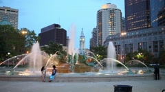 People at the Swann Memorial Fountain in city center at the evening Stock Footage