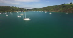 Aerial arriving at Waiheke Island from over the water Stock Footage