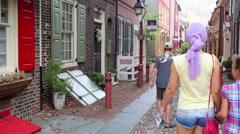 Mother with two children walks on the oldest street in America Stock Footage