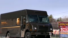 UPS mail truck, highway traffic Stock Footage