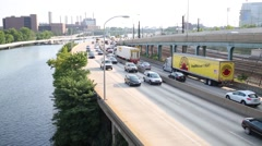 Car traffic on the Schuylkill Expressway and Schuylkill River Stock Footage